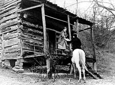 """""""Soon-to-be-Mother Receiving Books From Pack-Horse Librarian"""" Mill Creek, KY, WPA -  This young mountain wife shortly is to become the mother of her first child. The WPA Pack Horse Librarian has for months furnished her with literature on hygiene and the care of infants."""