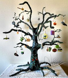 I just finished my Halloween Advent Calendar. I sculpted the tree using PAPER MACHE (RECIPES: http://www.ultimatepapermache.com/paper-mache-recipes) The ornaments are made of polymer clay, numbered for each day in October, and fitted with Swarovski crystals. The armature is wire; bulked a little with foil and masking tape.(LINK=>SITE OFFERS TUTORIALS, GALLERY, ETC)