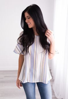 How fun is our new Abigail Striped Tunic? It is the perfect piece to vamp up your spring wardrobe! From the slight bell short sleeves to the colorful vertical stripe design to the semi-loose fit, this top is a dream!
