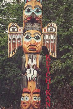 Alaska - Ketchikan, Fogwoman Totempole    Ketchikan    Fogwoman - the most popular of all totempoles, stands watching over beautiful Totem Bight State Park, Ketchikan, Alaska.    postmarked in 1995 with a USA flag stamp