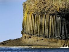Columns of Basalt; these basalt columns are near Fingal's Cave. The columns formed when cooling lava flows met bedrock and the region's cold weather - Staffa Island, Scotland
