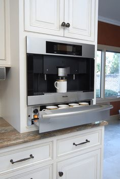 Built in Coffee Machine w/ cup warmer drawer. Cabinetry by QCCI. Designed by Kitchens Unlimited.