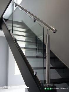 An open tread black oak staircase with steel rail & glass balustrade. Glass risers add to the feeling of openness while ensuring this new flight meets current building regulations Black Stair Railing, Steel Railing Design, Staircase Railings, Black Stairs, Bannister, Glass Stairs Design, Home Stairs Design, Interior Stairs, Reling Design