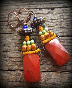 rectangles of faceted gorgeous stones of Red Jasper swinging freely from copper wire with weaved glass and African Beads of bursting colors. Wire Wrapped Jewelry, Wire Jewelry, Boho Jewelry, Jewelry Crafts, Beaded Jewelry, African Beads, African Jewelry, Baubles And Beads, Beads And Wire