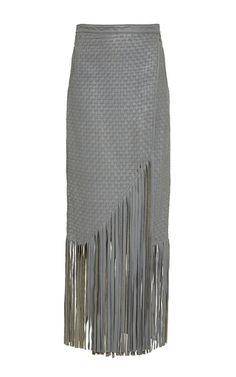 The Columbian designer, fashion ambassador, and star on the rise works with indigenous communities in her homeland to craft her feminine, sophisticated Tropicana pieces. Woven by hand, this **Johanna Ortiz** skirt features a wrap front, side pockets, an asymmetrical fringed hem, and a self tie obi belt.