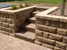 Landscaping, paver block stairs in hill with retaining wall
