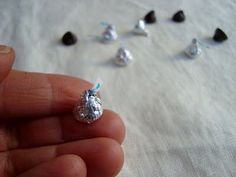 Elf leaves miniature kisses (made from chocolate chips)