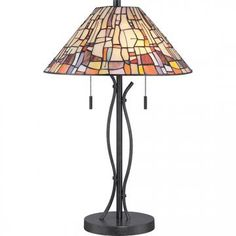 Embellished in a bright color palette, the Quoizel Tiffany Stinson Table Lamp,/strong> showcases a unique geometric design over a Tiffany. Stained Glass Table Lamps, Tiffany Stained Glass, Stained Glass Panels, Tiffany Style Table Lamps, Tiffany Lamps, Tiffany Art, Craftsman Style Decor, Outdoor Path Lighting, Night Light