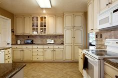 Cabinets Telisa Furniture Cabinet Refinishing Provo Orem Blue Cream Love Family Home Kitchen With Stainless Steel Appliances Design