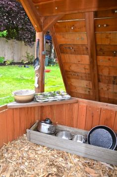 Our mudpie kitchen under the playstructure.  Cupcakes, anyone?