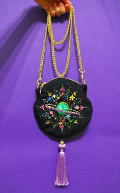 """""""Infinite Universe"""" Clutch, """"The Sacred Universe"""" Cross-Body Bag, Embroidered Coin Purses and UFO Pins by Oliness Art Studio on Etsy See our embroidery o Embroidery Bags, Beaded Embroidery, Cross Stitch Embroidery, Costura Diy, Unique Purses, Galaxy Print, Embroidered Clothes, Fabric Bags, Purses And Bags"""