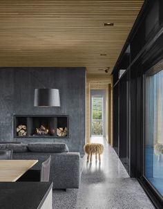 Located on the coast of Iceland, this holiday home has an open plan living arrangement and features a material-palette comprised of concrete, cedar and glass. Concrete Fireplace, Concrete Wood, Concrete Floors, Concrete Houses, Interior Design Examples, Interior Design Inspiration, Design Ideas, Timber Ceiling, Storey Homes