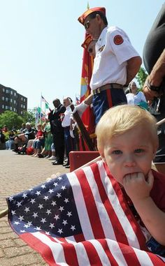 Tyler Curry, 1, of Brockton, during the Memorial Day observance in Brockton on Monday, May 28. Marc Vasconcellos/The Enterprise