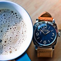 a drink and a Panerai