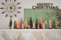 Hipster Holiday. Love this for holiday decor. I just saw Hollis on the new morning show Home and Family :) and she has some fab ideas...I had to check out her pinterest! I have a fireplace like this...where do I find trees like these, need to look into it.