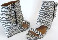 Here's a pair of the new trend in sandals with high ankle straps.. a must have for the update your shoe collection needs! $11.00!! Michael Antonio Sz 11  Cedric Aztec Print Wedge Sandals Black/ White