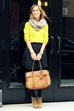 A yellow sweater + knit scarf + printed skirt + tights + ankle boots