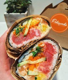 Pokéworks - New York, NY, United States. wasabi aioli ahi tuna and salmon burrito with masago, cucumber, mango, seaweed and lotus chips
