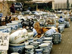 This is EXACTLY how a shop would look when I shopped for blue & white chinese procelain in a back alley in Macau, China.  A true adventure each time!