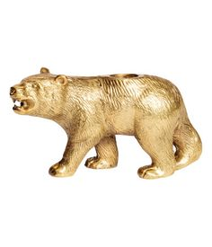 Gold-colored. Bear-shaped candle holder in metal. Size approx. 3 1/4 x 6 1/4 in.