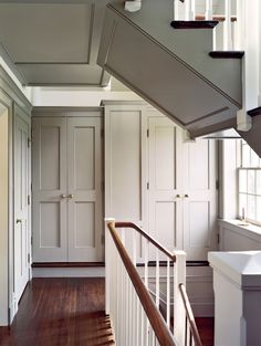 historic colonial house stairway with custom built ins and wall paneling