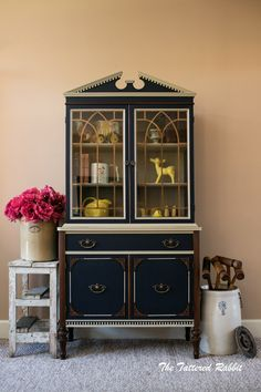 """This blue ribbon china cabinet was transformed by The Tattered Rabbit with the help of GF products! """"I wanted my colors to work together as a cohesive unit, with each complementing the other. I didnt want one color to outshine the other. So I chose Coastal Blue, Millstone, and Antique White from General Finishes Milk Paint line of products."""