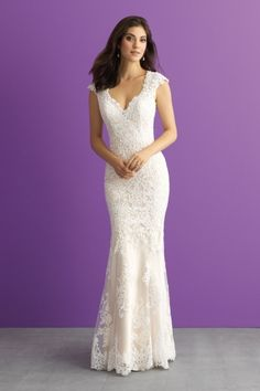 Allure Bridals - Reverie. Silk charmeuse adds a shimmering contrast to this lace sheath.