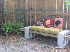 I saw this idea on Pinterest and made it a little simpler with just 6 concrete blocks and 3 posts. The cushions were from a repurposing center - the whole thing cost under $40.