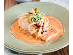 Salmon poached in Thai red curry
