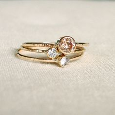 SOLID 14k Gold - Choose Three Stones - Set of Three Tiny Stack Rings - White or Yellow Gold - Delicate Birthstone Stacking Rings by MARYJOHN on Etsy https://www.etsy.com/listing/70900333/solid-14k-gold-choose-three-stones-set
