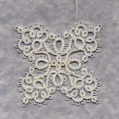 Butterfly Snowflake.  Book:  Tatting by Myra Piper, now out of print.  Pattern:  No. 44.  Thread HH White 601 size 20.