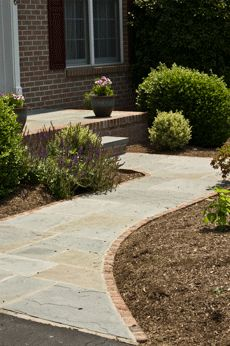 flagstone walkway with brick border