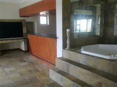 Situated in the safe surroundings of the Mossel Bay Golf Estate, this is what you can call home. With an inside braai area with a bar and jacuzzi, this is the ideal entertainers home. The big open plan kitchen and living areas opens up to the undercover patio. WEB REF: AMOS-0040  #house #golfestate #safe Golf Estate, 5 Bedroom House, Open Plan Kitchen, Undercover, Open Up, Jacuzzi, Living Area, Patio, Bar