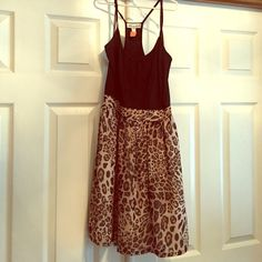 Leopard dress Leaped dress. Top is tight and bottom flares out. Worn once and dry cleaned. From Francesca's Boutique. Annabella Dresses Mini