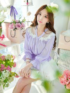Morpheus Boutique  - Purple Floral Long Sleeve Button Down Hem Shirt, CA$105.55 (http://www.morpheusboutique.com/new-arrivals/purple-floral-long-sleeve-button-down-hem-shirt/)