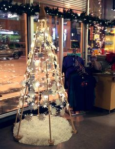 A snowflake tree at Snow City Cafe in Anchorage   The Jubiltree Company, LLC   Modern Wood Christmas Trees