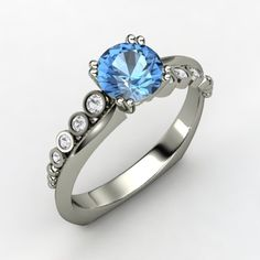 This would be great with a sapphire in the middle and then the kids birthstones down the sides