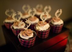 Plaid cupcake sleeves and deer toppers turn plain cupcakes into the perfect woodland dessert!