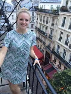 Hotel Europe Saint Severin fifth floor balcony ( my room with a view) lookout onto to a small street with restaurants and shop during the Paris night life. Solo female traveler
