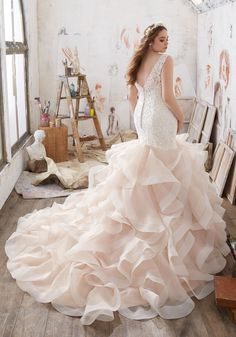 Designer Wedding Dresses and Bridal Gowns by Morilee. Beautiful Plus Size Lace Mermaid Wedding Dress with AppliquŽés that Adorn the Figure Flattering Bodice.