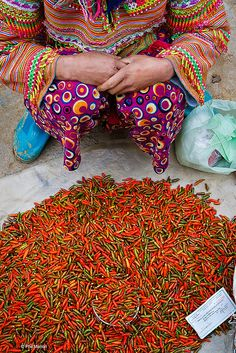 Chili peppers sold by someone even more colourful - Bac Ha market, Vietnam | Flickr - Photo Sharing!