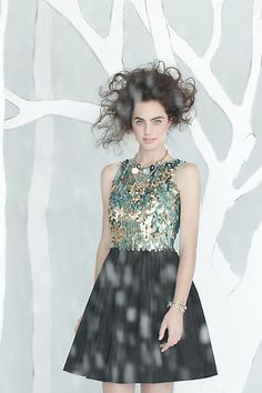 Interesting combination of skirt and shimmering top; love the embellishment, especially for holiday parties!