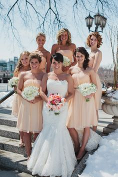 This bridal party looks stunning in Donna Morgan Bridesmaids Peach Fuzz Donna dresses! #weddings #DonnaMorgan