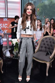 Selena Gomez in a Viktor & Rolf crop top, Moschino Cheap and Chic suspender pants, and Bionda Castana sandals