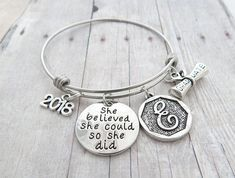 Graduation Bracelet for High School or College Graduate. Class of 2018 Graduate. Perfect gift for her on her graduation day. She believed she could so she did Charm bracelet. Includes: Stainless steel bangle bracelet 2018 Charm She believed she could so she did charm Initial