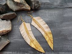 Gold feather earrings. Leather feather earrings. by VelmaGold feather earrings. Leather feather earrings. Long gold earrings. Gold dangle earrings. Beige earrings. Boho earrings. Bohemian earrings.Jewelry