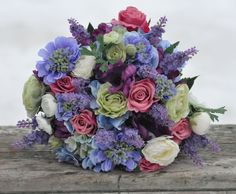 Raspberry pink roses, blue hydrangea with touches of purple and lavender wedding bouquet made of silk flowers.. $135.00, via Etsy.