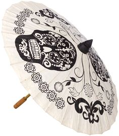 SUGAR SKULL PARASOL  Looking for the perfect parasol? Your search is over, nothing dazzles a summer dress and sandal wedge more than a parasol tossed upon your shoulder. Rendered in all black on rice paper, your outfit can do the talking, while the sugar skulls complement any summer worthy look! $20.00 #parasol #sugarskull #retro