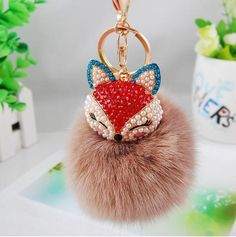 Cute Bling Rhinestone Fox Fluffy Ball Keychain. Click Picture to Purchase. https://liftingtheworld.com/collections/fluffy-balls-keychains