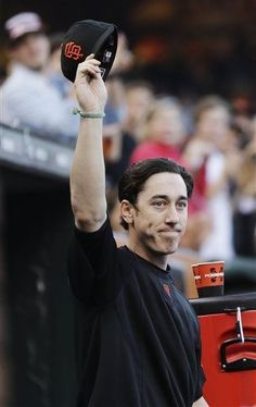 San Francisco Giants pitcher Tim Lincecum tips his hat to the crowd as he is acknowledged for throwing a no-hitter in his previous start against the San Diego Padres, during the Giants' baseball game against the Arizona Diamondbacks on Friday, July 19, 2013, in San Francisco